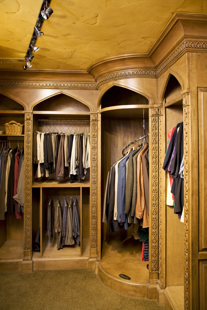 His closet features carved pilasters throughout and a coved cornice detail.