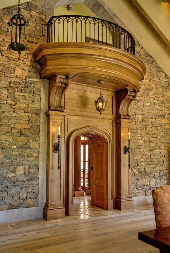 The entry to the library showcases panelled columns and oversized corbels.