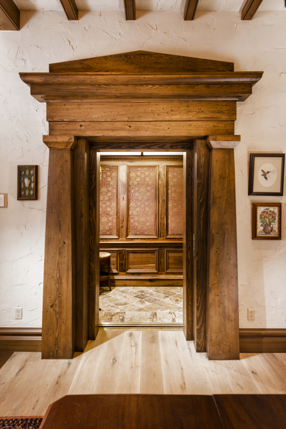 The map room elevator door. Elevator interior detailed in walnut.