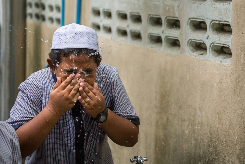 Boy Performs Wudu After Playing Football