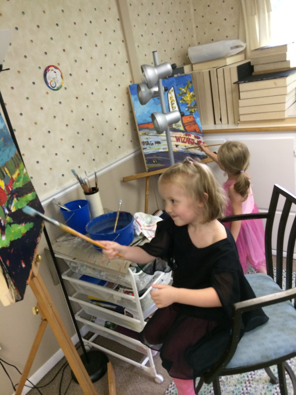 my kids like to grab dry brushes and pretend they're me, painting my paintings.