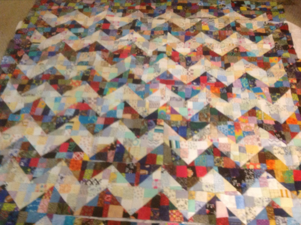Here is a list of of materials to make this quilt: assortment of dark print scraps (1/2 of bag) light print scraps (bag full) 3/4 yard for binding backing fabric batting