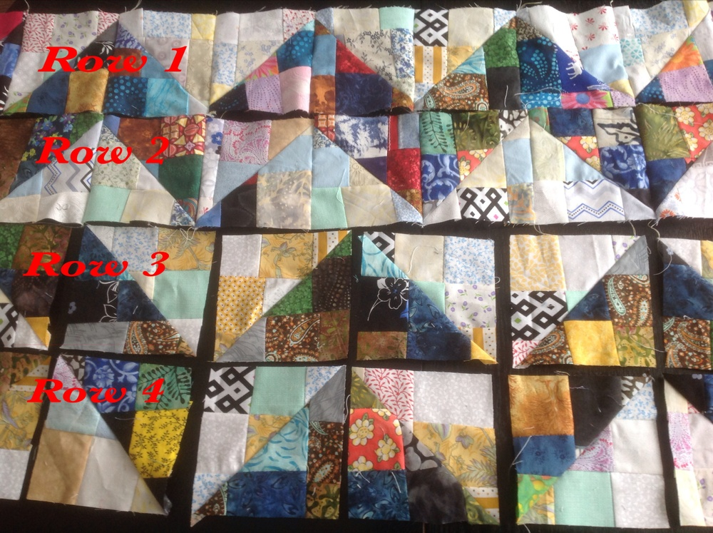 Lay out the blocks into this chevron pattern as pictured above.  Notice that row 1 and 3 are the same and row 2 and 4 are laid out the same. Add a dark block to each end of the row.  Use only black blocks for first and last rows.  The dark blocks create a border along the 4 sides of the quilt.  You can see it better in the pictures above.