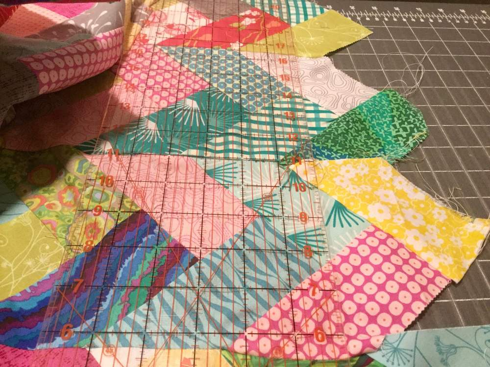 I attempted to cut the ends off as shown in the Missouri Star Quilt Tutorial but my seams did not match up.  So, I sewed 8 braids together and cut all of them at one time.  Watch the video and you will understand a bit better.