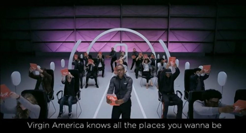 American Idol star Todrick Hall (center) created the music and lyrics for Virgin America's new safety video. It's a remix of the airline's popular 2007 hand-drawn video. (VIRGIN AMERICA)