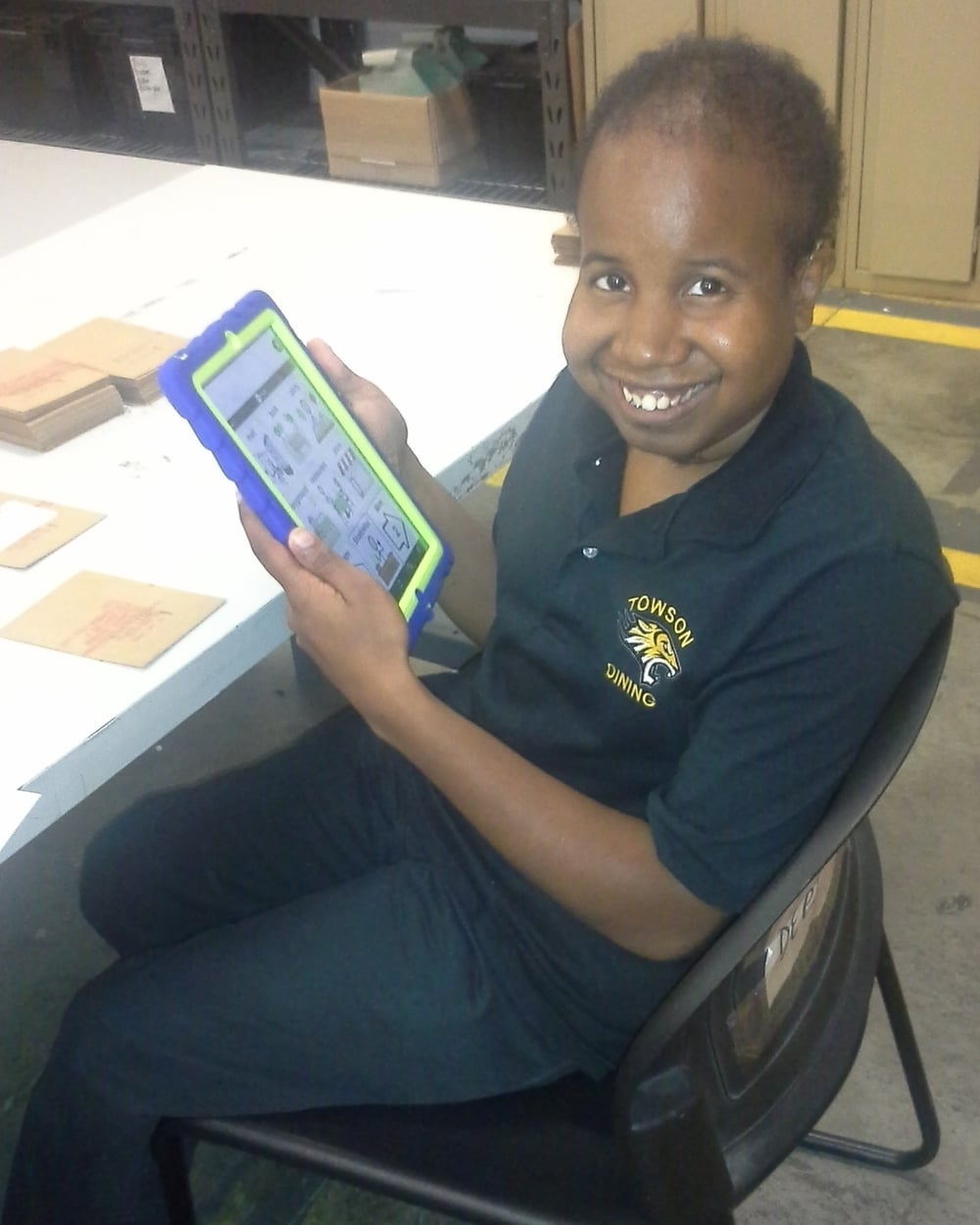 Giovann Green is shown here with his iPad and Otterbox case provided by Andrew's Gift. He is very excited to be able to utilize his iPad and ProliQuo to communicate with his coworkers and staff at his day program.