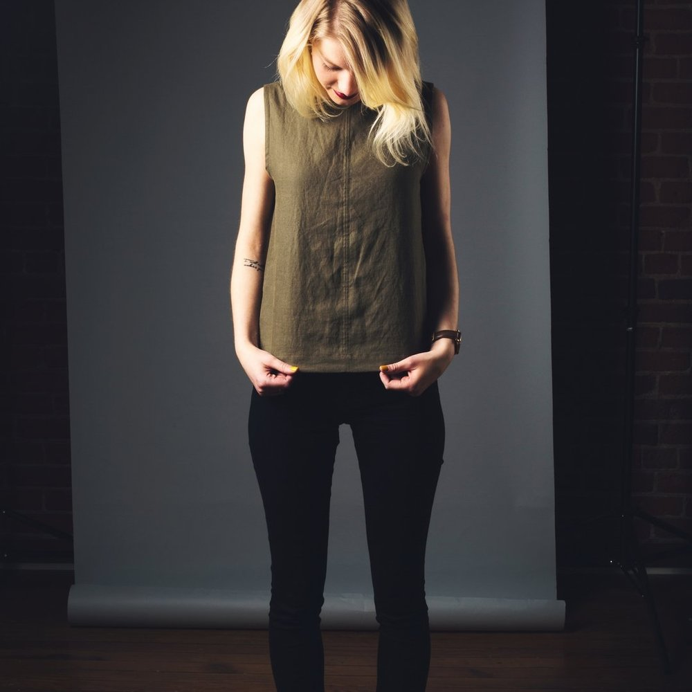 "Rebecca Moon - Fashion. Rebecca Moon is the mother of Apollo and Daphne and Rebecca Moon Designs.This garment, the Hemp ""Denver"" Crop, is the perfect peach-picking top--or really, perfect for any occasion. The olive-toned hemp gives it a warm and rustic feel, but structure and clean lines are the epitome of sophistication. Wear this soft linen-like hemp top alone or with a cardigan for a new kind of everyday essential. Organic, ethical, vegan friendly. 100% Hempcel (65% Hemp/45% Lyocell) @rebeccamoondesignsltd"