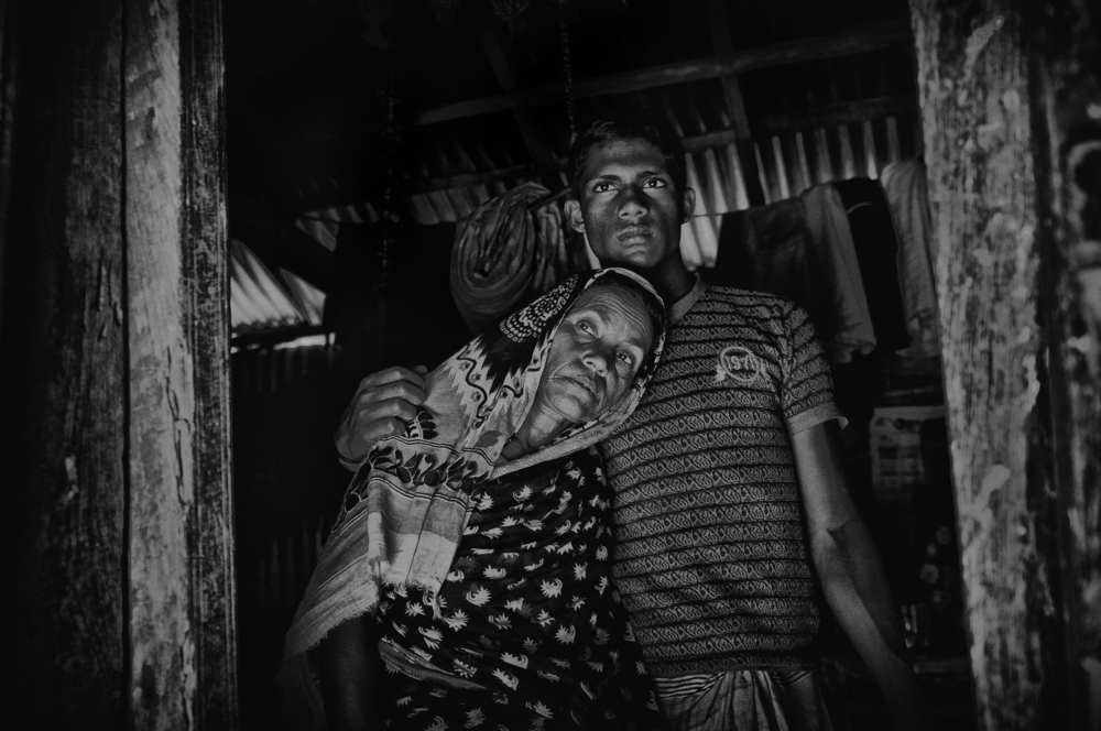 Hamida (45) is a native who lost both her husband and son in two consecutive years. They both died because of tiger attacks. She is going through a lot of sufferings, As her daily income is less than a dollar. She doesn't let her younger son to forest; she would rather let him unemployed.