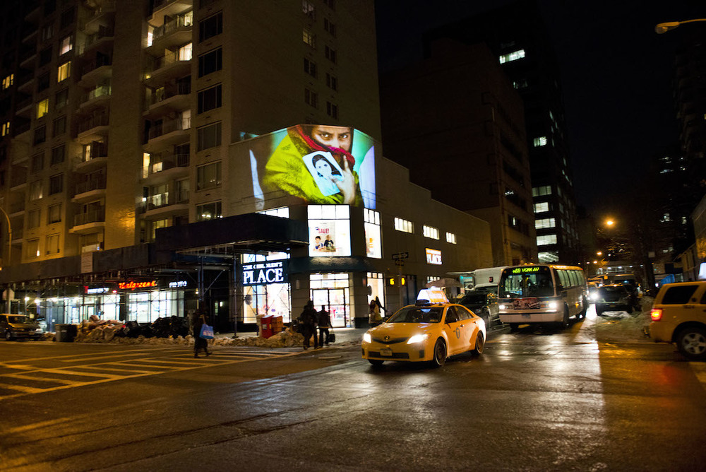 Photo from Rana Plaza collapse on the wall of Children's Place in NYC. Photo: Ismail Ferdous
