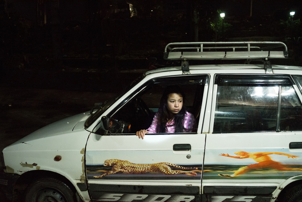 The wife of a taxi driver sits in her husband�s taxi in Kathmandu, Nepal, April 27, 2015. Afraid that their house is unsafe, the driver keeps his wife close by as they drive around the city together.