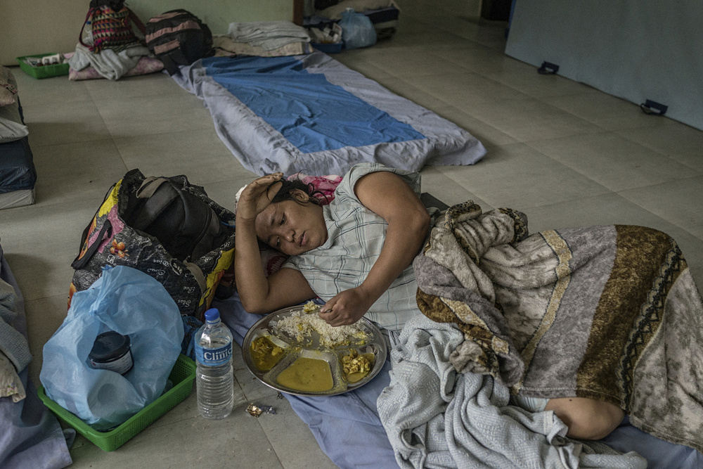 A woman injured in the earthquake lies in Kirtipur Hospital in Kiritipur, on the outskirs of Kathmandu.