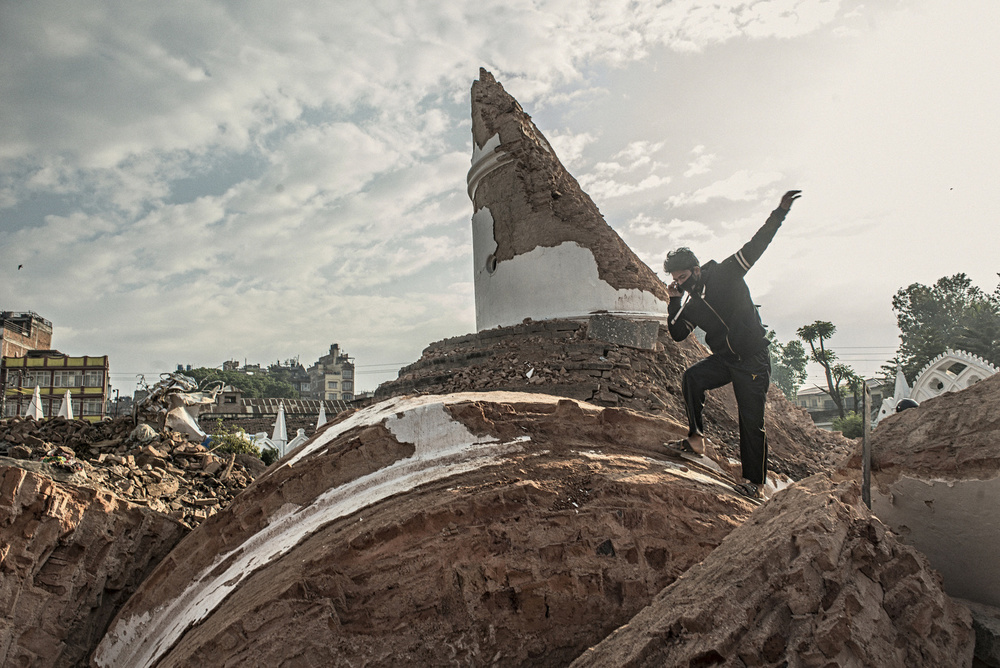 A man stands on top of the broken Dharahara tower in Kathmandu, April 29, 2015.