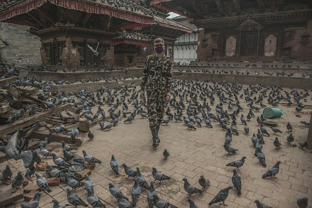 A member of the Nepali army walks in front of Kal Bairam Temple in Darbar Square in Kathmandu, April 29, 2015.