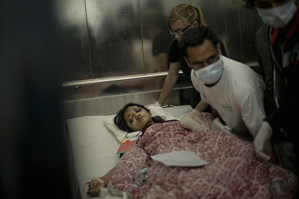 A victim of the earthquake is taken to an operating room at Bir Hospital in Kathmandu, April 29, 2015.