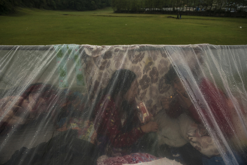 A family makes a temporary shelter on a golf course in Kathmandu, April 28, 2015.