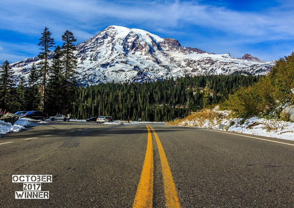 "Mark Voigt  ( IG @mark.voigt)  Is The October GO Newsletter Photo Contest Winner! The theme ""On the road again"". This is an epic Photo Mark. One of the judges commented ""The yellow line draws your eye into the shot and directly to the peak of the mountain"". Great composition and awesome use of that leading line to point out your subject. This is classic great work. Congrats!"