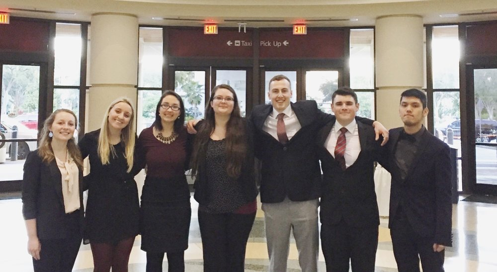 """Named """"best dressed team"""" for Day 1 of presentations,from left to right: Megan Rajner, Erica Stankus, Griffin Sacco, Jacqueline Horner, Mathew McKinnon, Zachary Downing, and Leo Canales-Wong."""