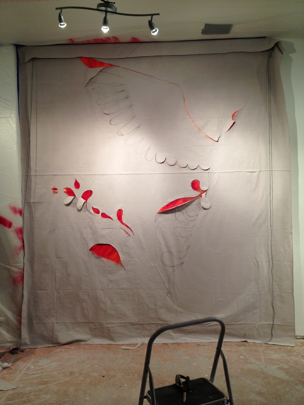 Next, I covered the bottom layer with canvas, and began cutting out a massive bird.