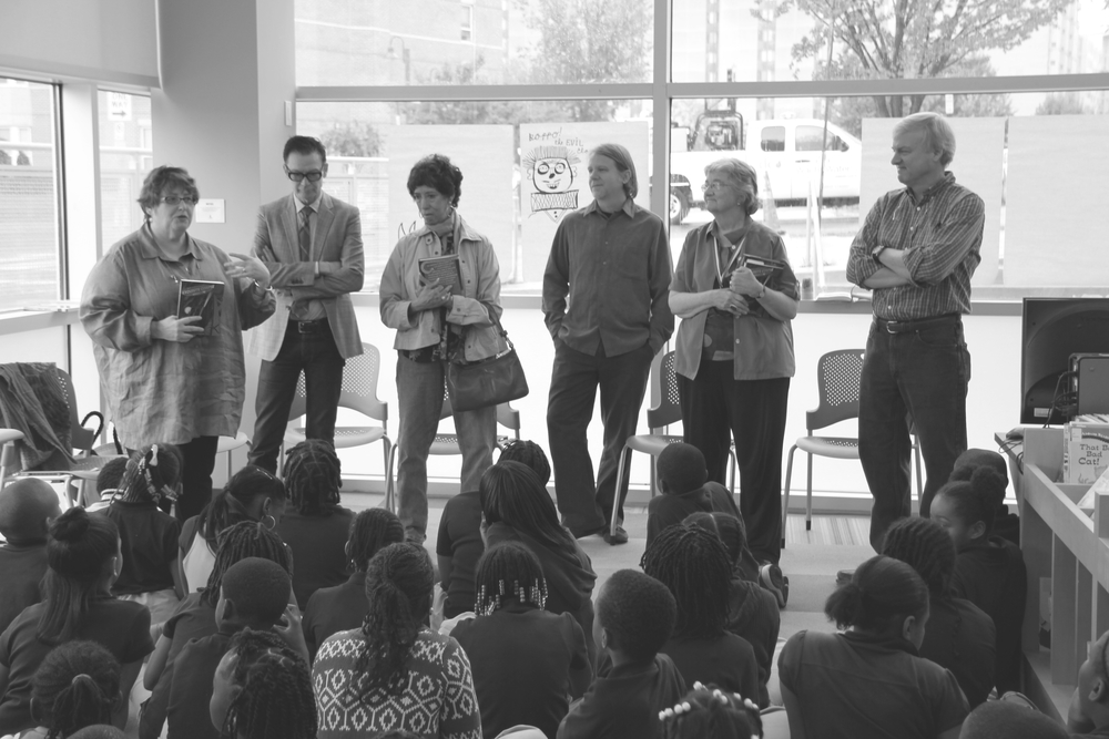 Mary Brigid Barrett, on far left with, left to right, authors and illustrators Jack Gantos, Patricia McKissack, Calef Brown, Katherine Paterson, and Chris Van Dusen, giving a presentation to students from the Washington DC public schools.