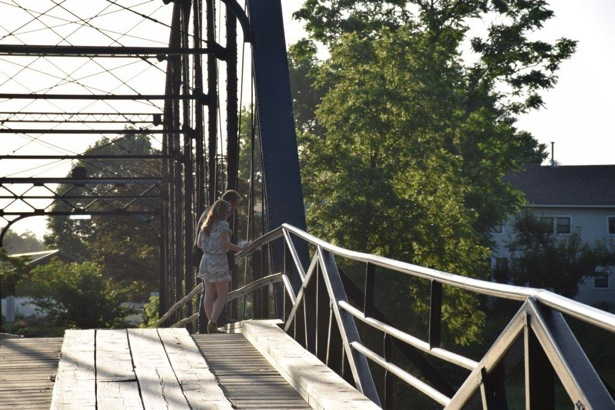 "The only way Josh could think of getting Candice out to War Eagle Mill was to tell her they had a fancy meal planned with friends at a restaurant nearby. ""Coincidentally"" the restaurant was closed so the two decided to take a walk along what we all know as War Eagle Bridge."