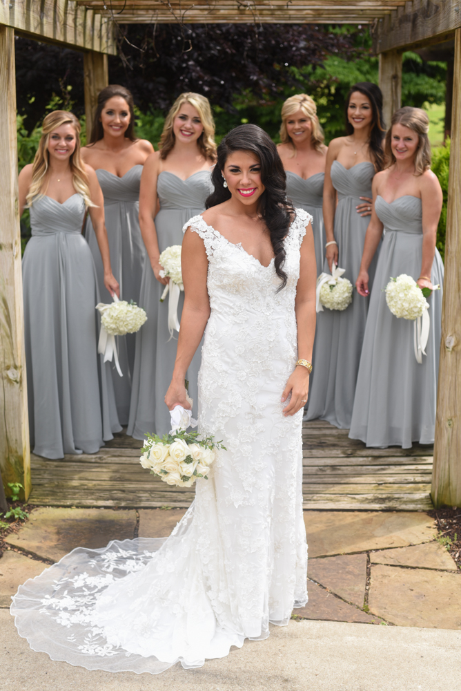 Gabbie and bridesmaids all in dresses from Tesori. Photography by Delyn Stirewalt.