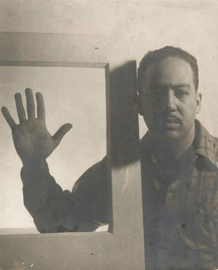 Gordon Parks,  Langston Hughes, Chicago, December 1941.  Gelatin silver print, 13 1/8 x 10 5/8 inches. © and courtesy The Gordon Parks Foundation.
