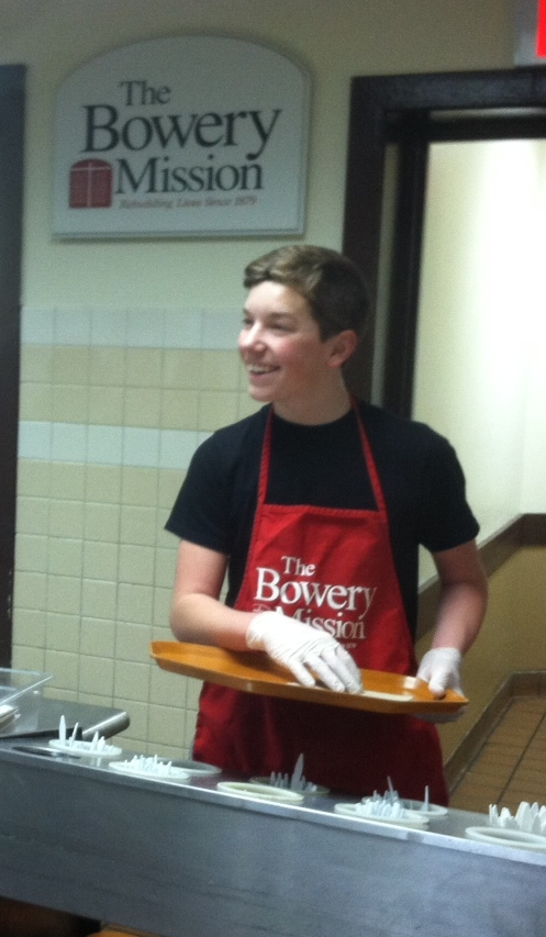 Xavier Moll, an eighth grader from our East Side location, serving at the Bowery Mission.
