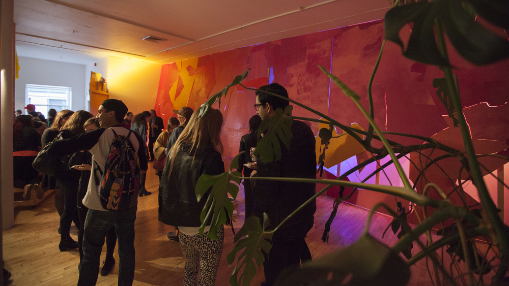 Lisi Raskin's   Flat Screen (Pink Wall)   lights up the room at the opening of the group show   you know it when you feel it   as part of Lisi Raskin's   Recuperative Tactics  , Art in General, April 19, 2014. Image credit: Steven Probert