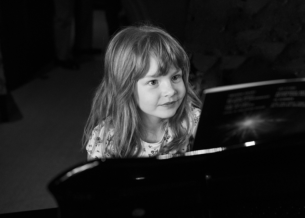 Eliza playing piano before mummy and daddy's wedding