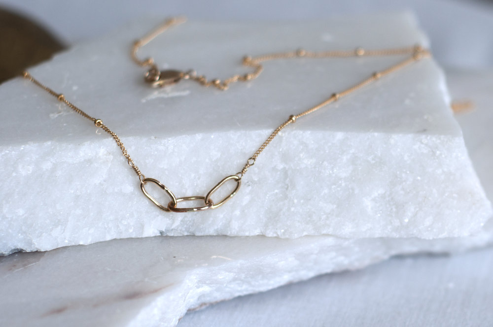 Three Chain Necklace Hand fabricated chain out of 14k gold fill, hanging from a delicate 14k gold fill chain. $114.