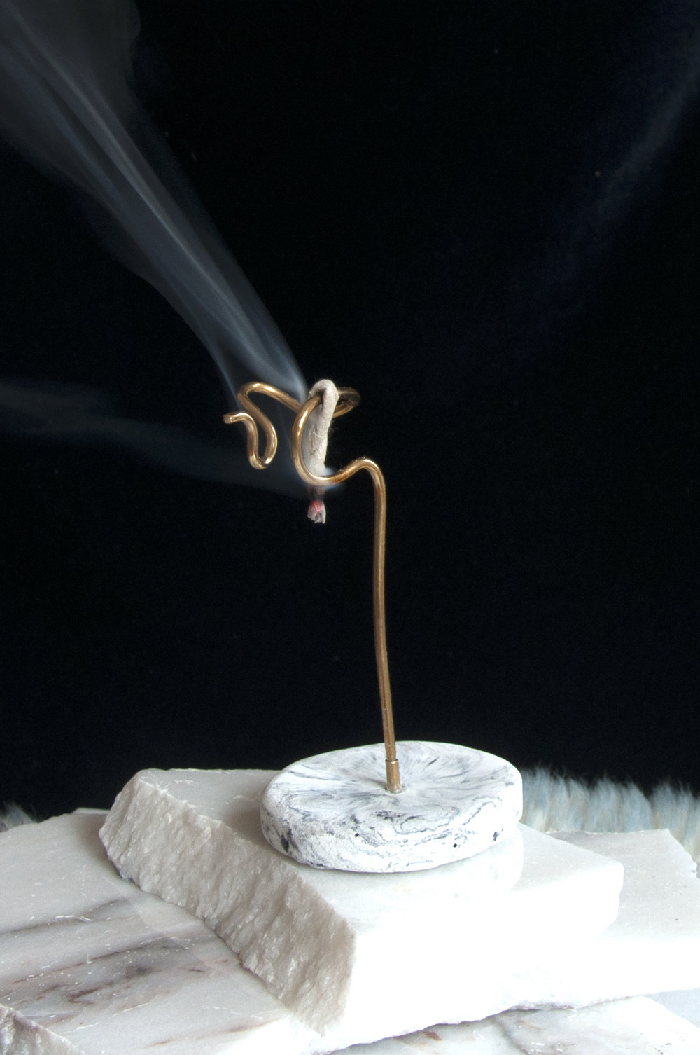 Intertwined Rope Incense Holder   Each base is made of high grade concrete that is marble while pouring into base molds. The top half is made by bending think gauge wire. The piece is modular to accommodate stick incense as well.