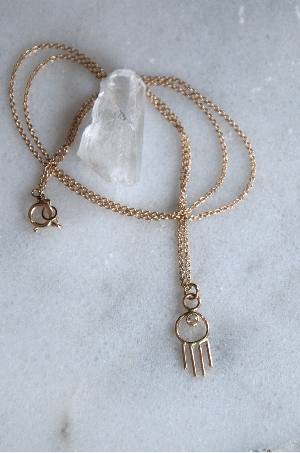 Little Ray Necklace Hand fabricated charm from solid 14k gold, with white saphire stone.