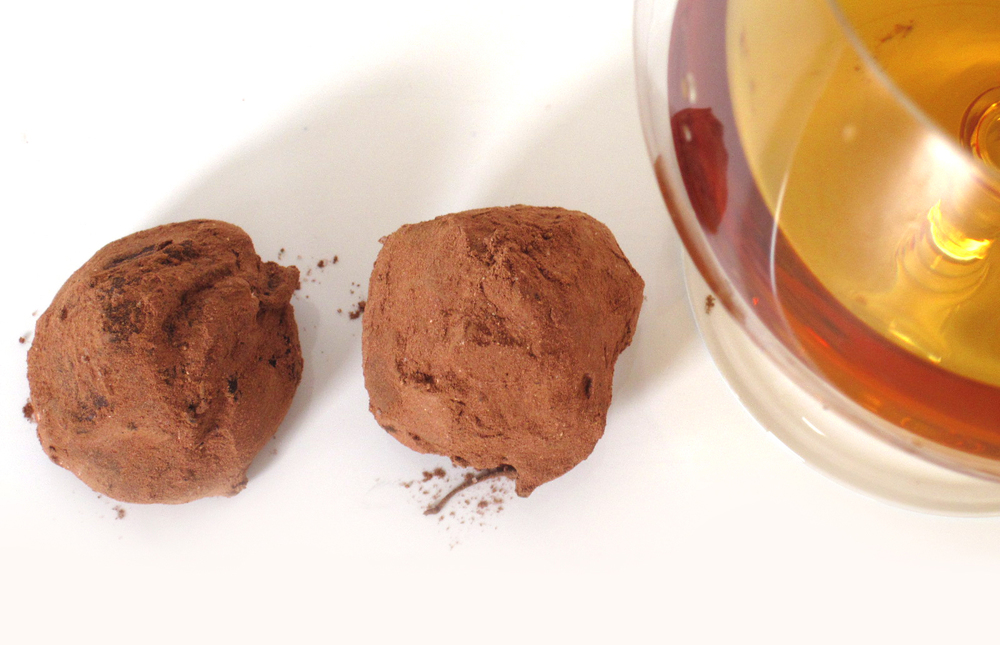 Serious milk chocolate center blended with fine cognac, dipped into 68% dark couverture and rolled in sweet cocoa powder.