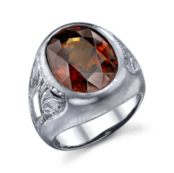 2009 Spectrum - Manufacturing Honors Men's Wear    Ricardo Basta Fine Jewelry & E. Eichberg Jewelers   Palladium ring featuring a 19.68 ct. oval brown Zircon.