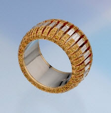 "2007 Spectrum - Honorable Mention Classical    Ricardo Basta Fine Jewelry & E. Eichberg Jewelers   18K yellow gold and platinum ""Flying Baguettes"" eternity band featuring Diamonds (1.94 ctw) and natural yellow Diamonds (1.20 ctw)."