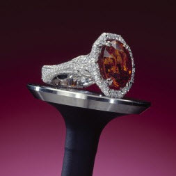 2004 Spectrum - 1st Place Bridal Wear    Ricardo Basta Fine Jewelry & E. Eichberg Jewelers; Designer: Ezequiel Safdie   Platinum ring featuring a 12.65 ct. orange Garnet accented with Diamonds (1.20 ctw).
