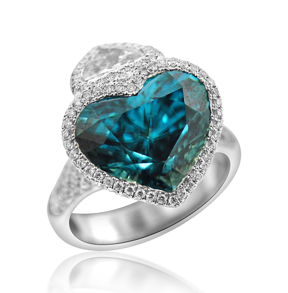 "2017 Spectrum - 1st Place Bridal Wear    Ricardo Basta Fine Jewelry & E. Eichberg Jewelers   18k white gold and rhodium ""Double the Love"" ring featuring 12.62 ct heart shaped blue Zircon accented with .75 ct heart shaped Diamond and Diamond pave (1.53 ctw)."