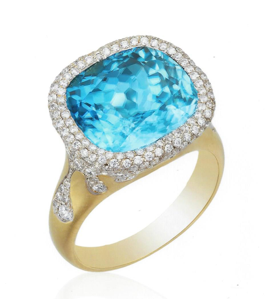 "2017 Spectrum - Classical Manufacturing Honors    Ricardo Basta Fine Jewelry & E. Eichberg Jewelers   18k yellow gold rhodium ""Blue Lagoon"" ring featuring a 13.99 ct cushion-cut blue Zircon accented with Diamond melee (1.32 ctw.)"