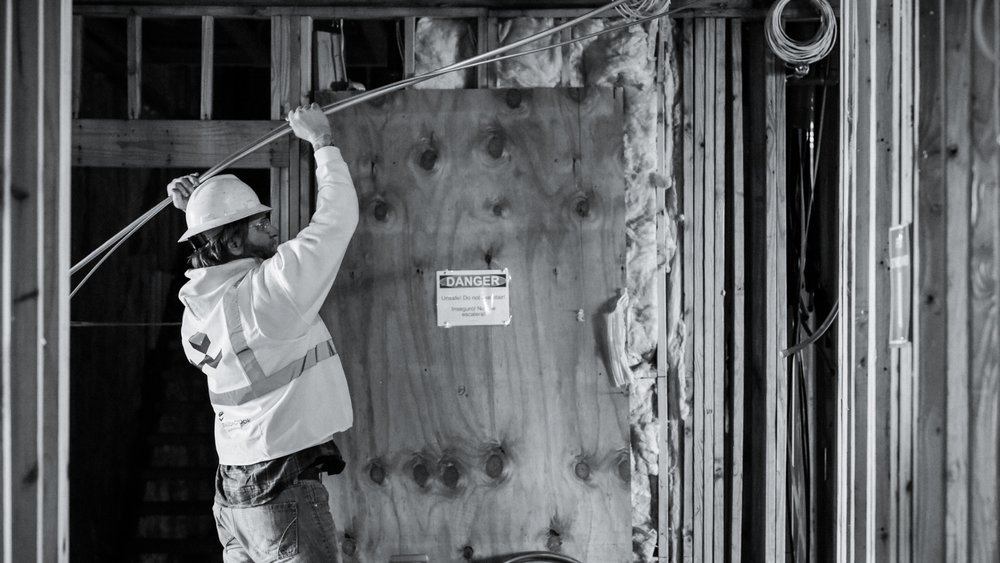 worker running electrical lines b&w.jpg