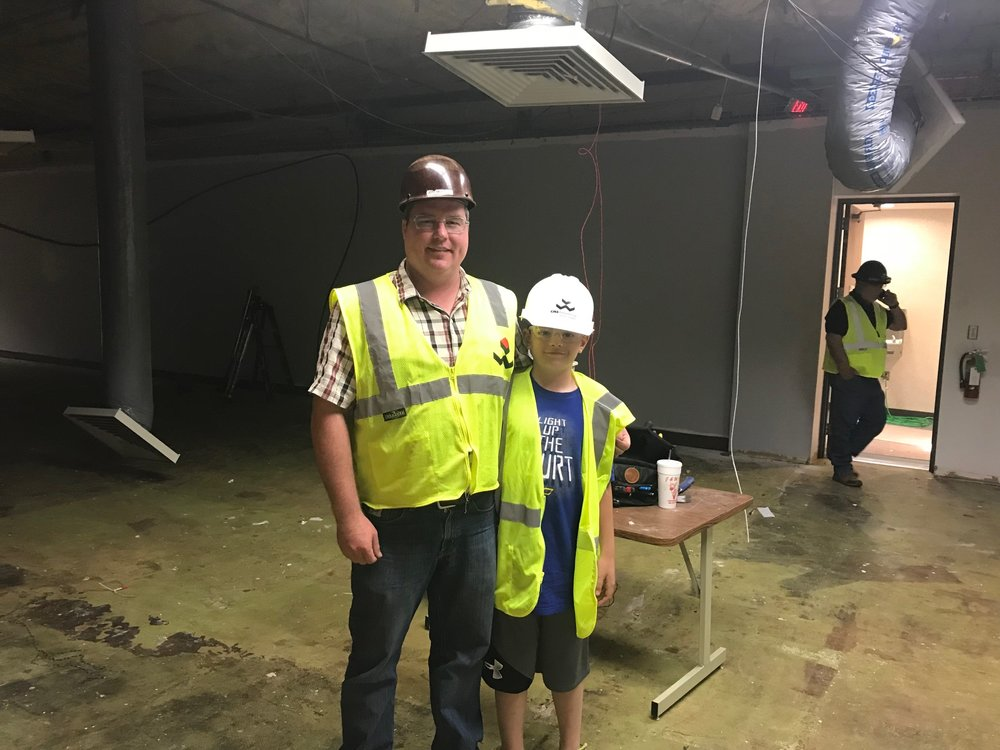 Jeff McClure with son Carson at jobsite