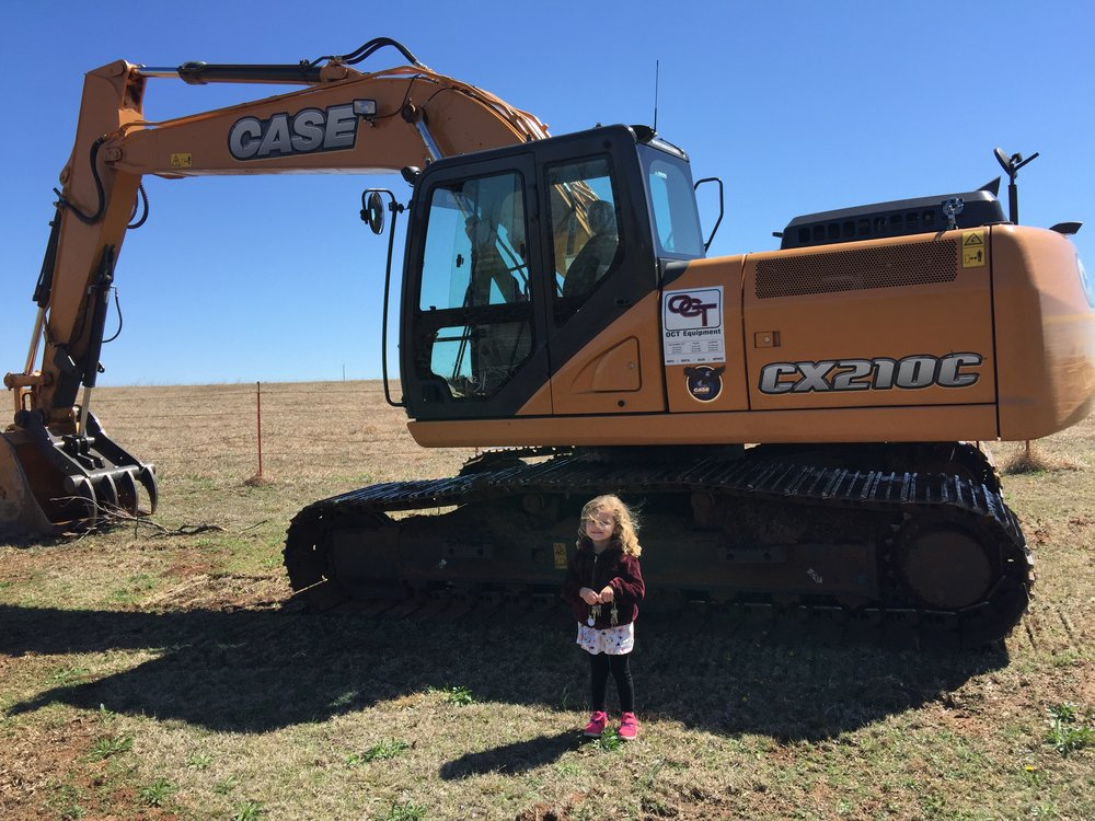 Ella Claire by an excavator