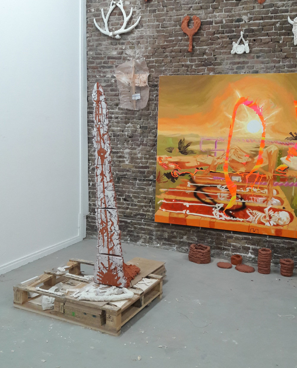 """Earth totem"", Acrylic spray paint on terra cotta, Installation shot at Rijksakademie Open, ceramic pots and plants in collaboration with Heidi Howard"