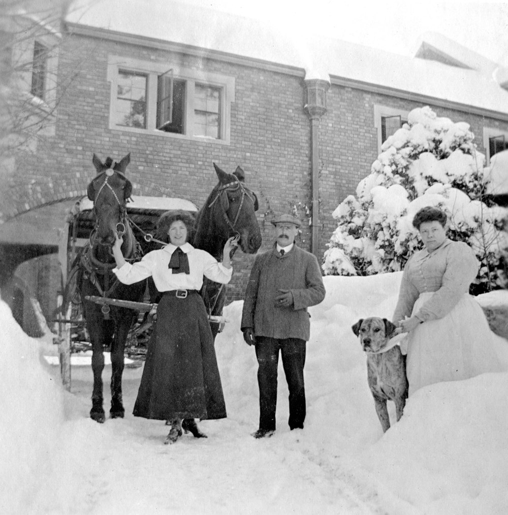 After General Palmer's death in 1909, his staff continued to care for the property. This is a picture of Carl Fohn and some of the female servants on a snowy day.