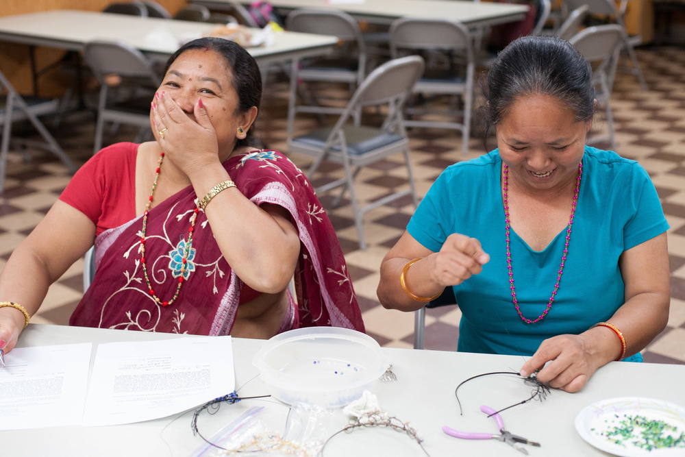 Beading and writing - Mina and Chandra laughing.jpg