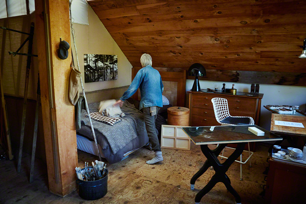 Pillippe tidying up the barn's living quarters