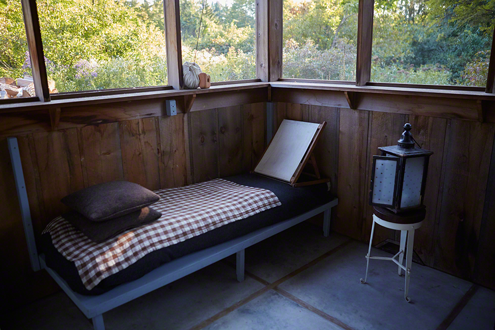During hot nights, the screened-in summer porch is the perfect place to sleep. No air conditioner required.