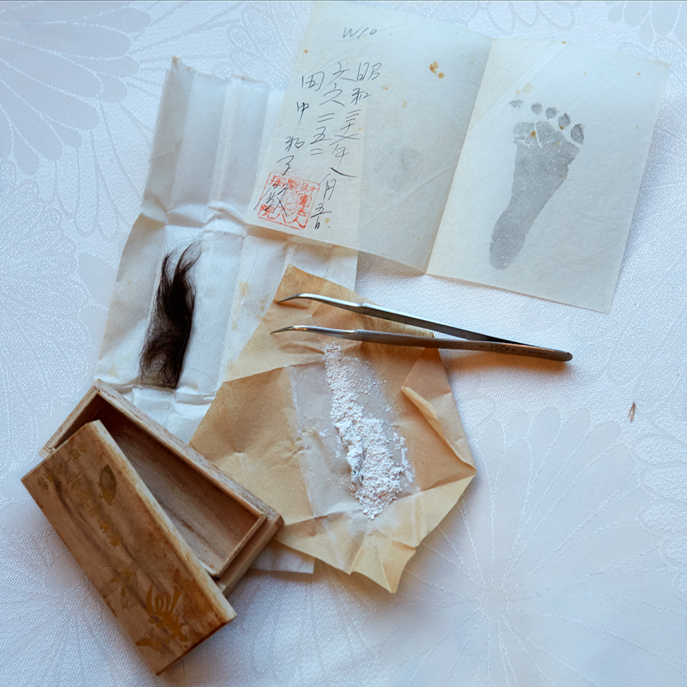 The 'Inheritance;' her umbilical cord preserved in talc powder, next to a lock of her hair and footprint