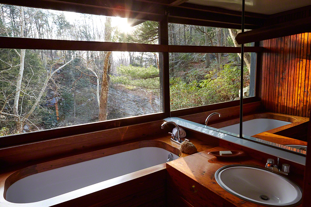 """This is my bathroom. On opening the door, I wish you could smell the aromatic red cedar. It amuses me that people often say, ""Oh, you have a Japanese bathroom"" because there is nothing Japanese about this bath; the whole concept was taken from a rosette car on the Pullman train. The 6' window slides down into the sill"""