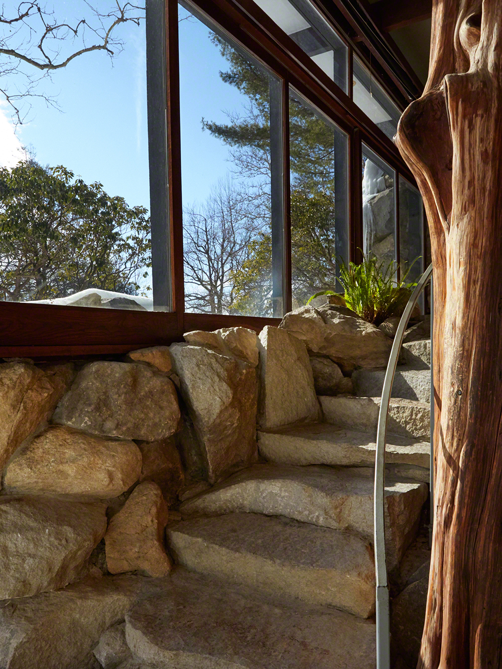 """In many ways the house is a study both of blending and contrasting. For instance, by 'blending' I mean that rocks, boulders, and even trees are brought into the house."""
