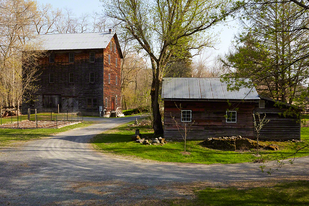 Metzner's 100+ year old mill sits on 42 acres next to the creek. The former stable to the right is now a shed.